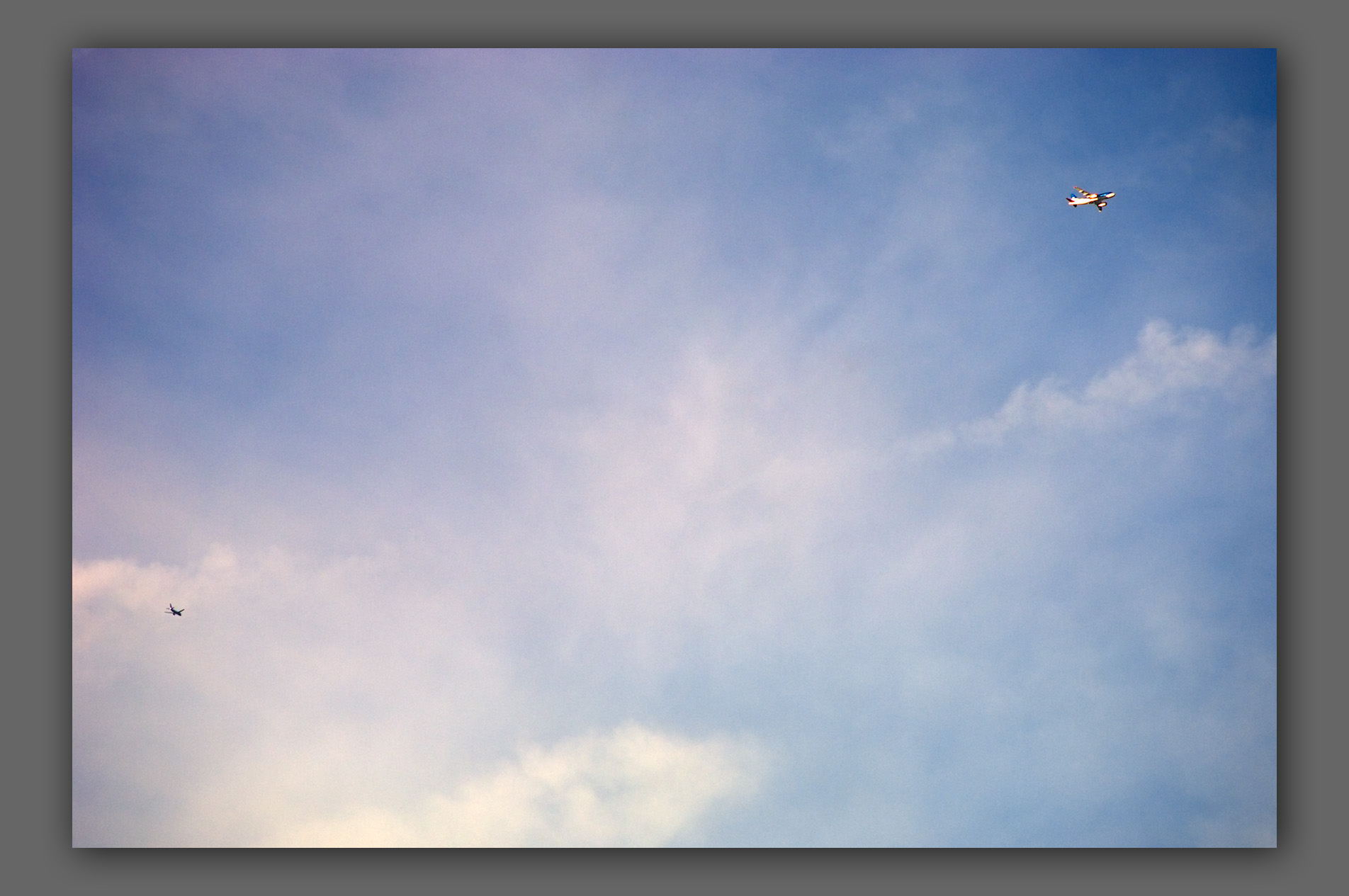 """Two airplanes, clouds and sky - from the """"Out of Nowhere"""" series"""